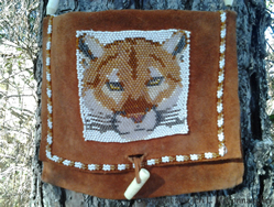 Cougar pattern design on leather pouch